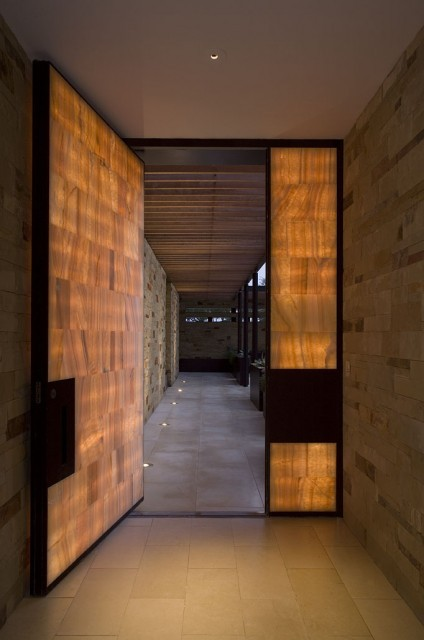 Contemporary entry door made with wood and glass pane