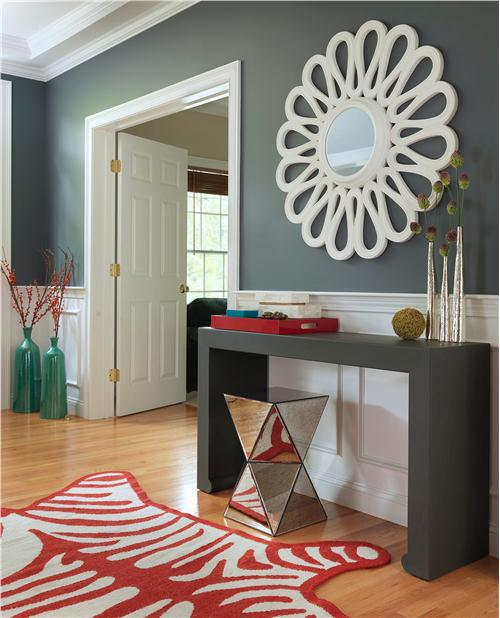 Contemporary entry with fancy rug on foyer
