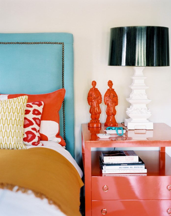 Eclectic Bedroom Decorating ideas with coral colors bedside table bold colors bright colors decorative