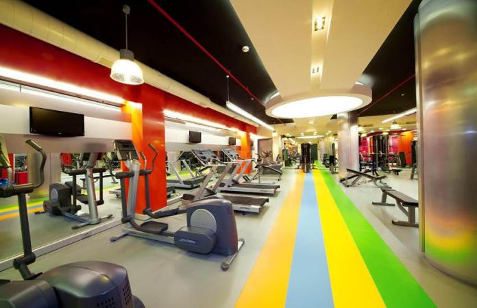Fitness center with Ceiling Treatments and Pendants
