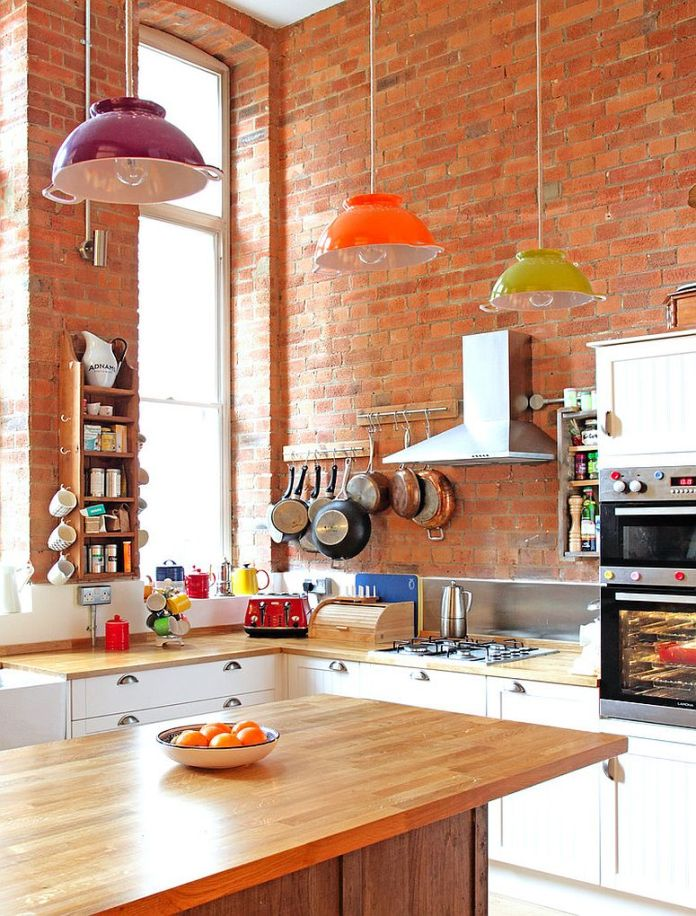 Eclectic kitchen with brick wall backdrop