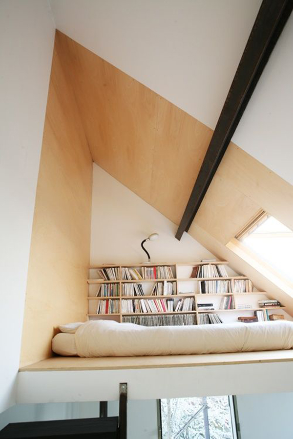 Impressive loft bedroom with library