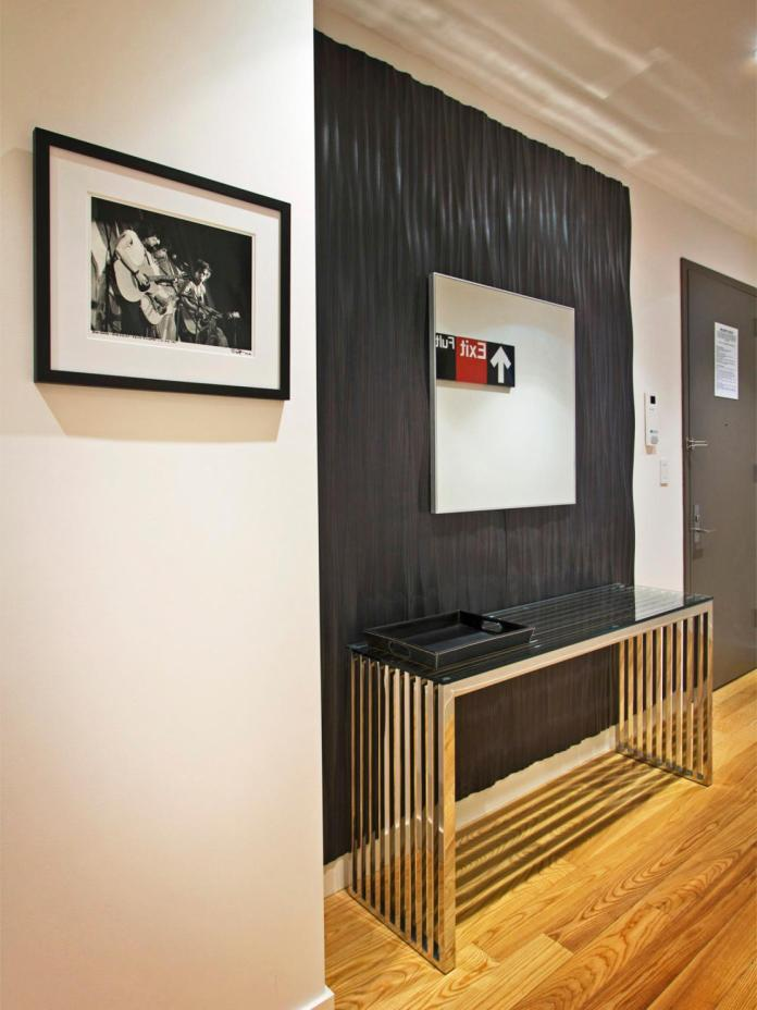 Contemporary Entryway With Ebony Accent Wall