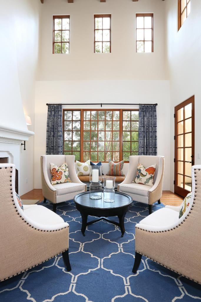 White Mediterranean Living Room With Blue Rug