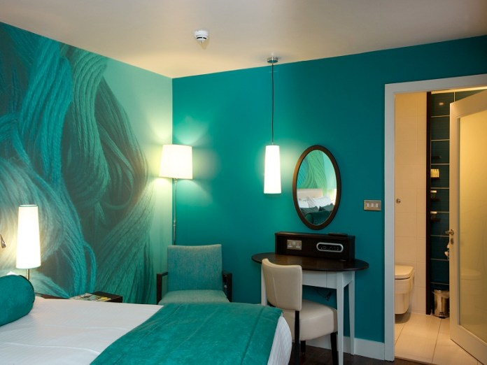 Small Bedroom With Turquise Color Paint and Wallpaper