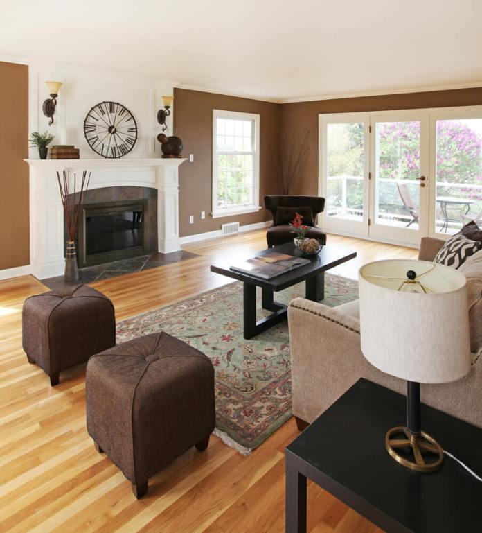 Light Hardwood Flooring With Patterned Rug