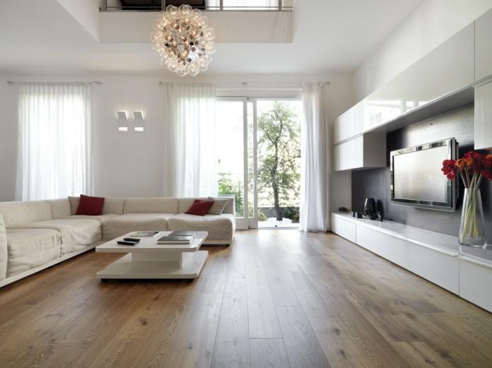 All White Modern Living Room With Semi Gloss Wood Flooring