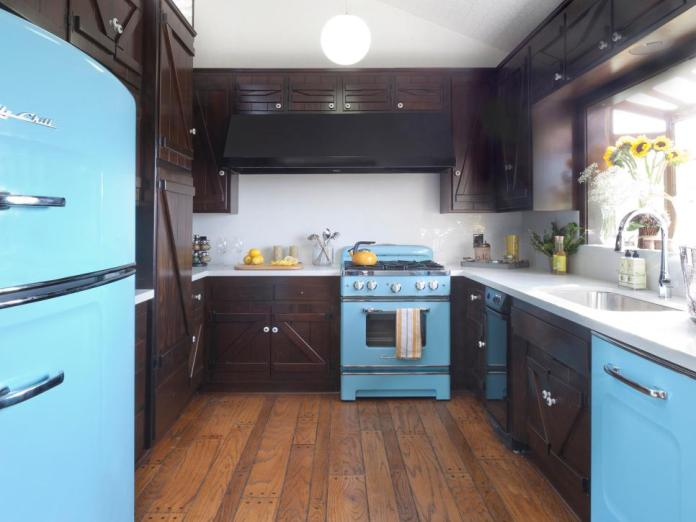 Kitchen With Marble Countertops and Dark Brown Cabinets Along With Sky Blue Fridge & Cookware