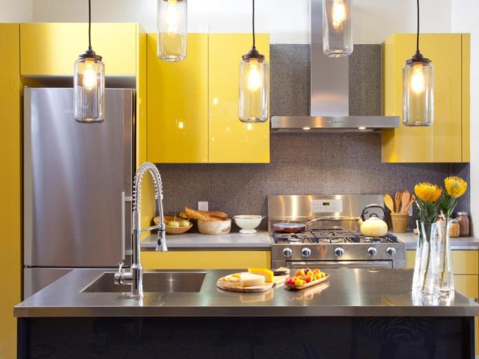 Modern Kitchen With Stainless Steel Countertops & Yellow Cabinets dwellingdecor