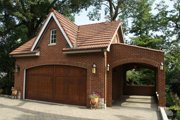 Brick Garage Design With Solid Wooden Doors Dwellingdecor
