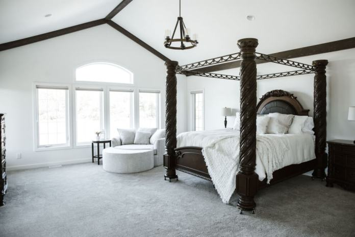 cottage carpeted and gray floor bedroom