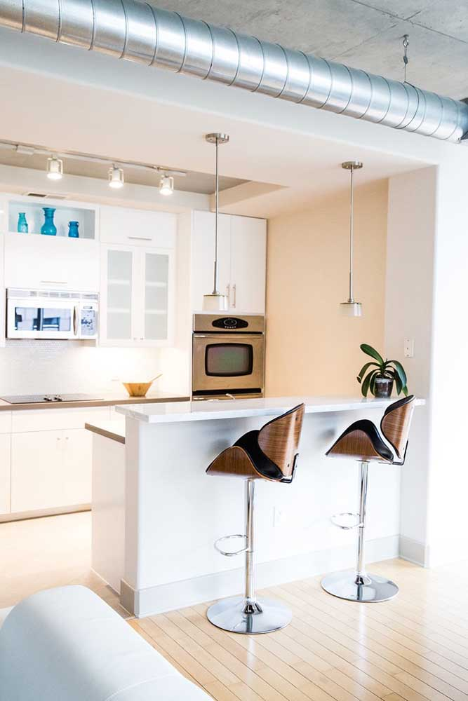 02. Small modern planned kitchen with custom furniture;highlight to the pendants above the counter.