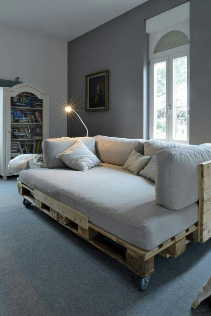 16. Large pallet sofa model with light can make the place much more intimate