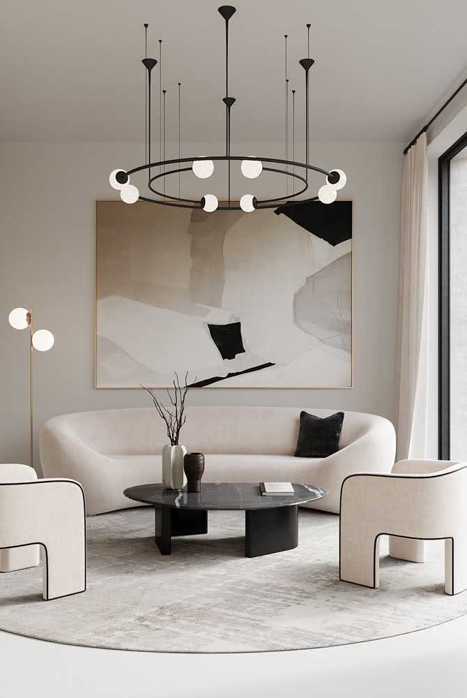 34 - Round modern chandelier accompanying the shape of the living room furniture in perfect harmony