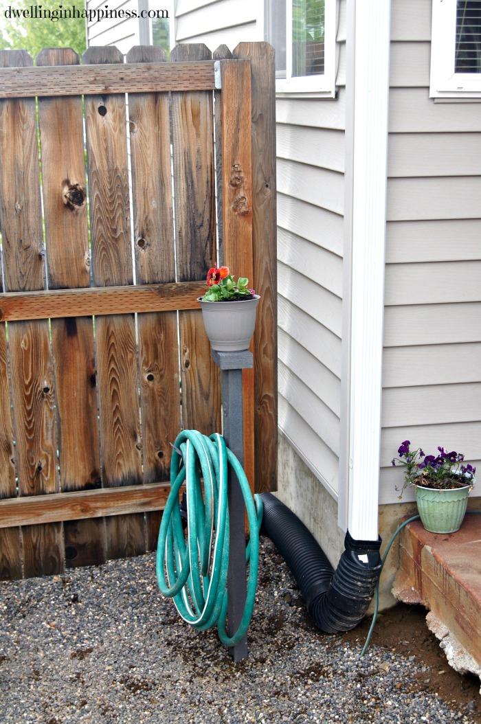 DIY Garden Hose Storage Dwelling in Happiness