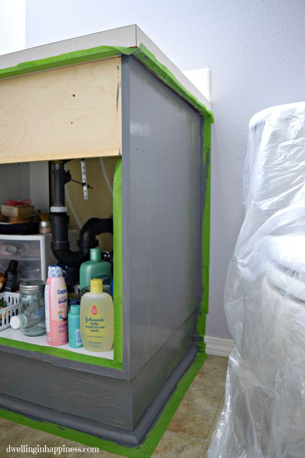 Painting Your Vanity The Easy Way! No mess, no primer, just a pretty vanity.  From Dwelling in Happiness