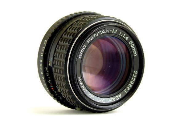 Uma 50mm f/1:1.4 fungada sendo desmontada e limpa - DXFoto - Frente