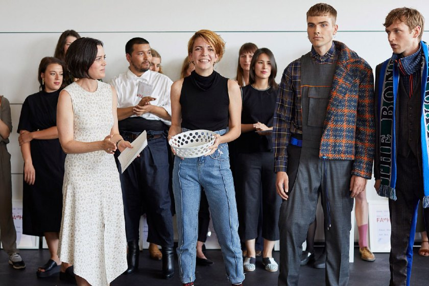 Jury member Andrea Unterberger (Akris) presents Maria Presser with the 1st prize European Fashion Award FASH 2018 in the category graduation theses. Photo: © Bernhard Ludewig / SDBI