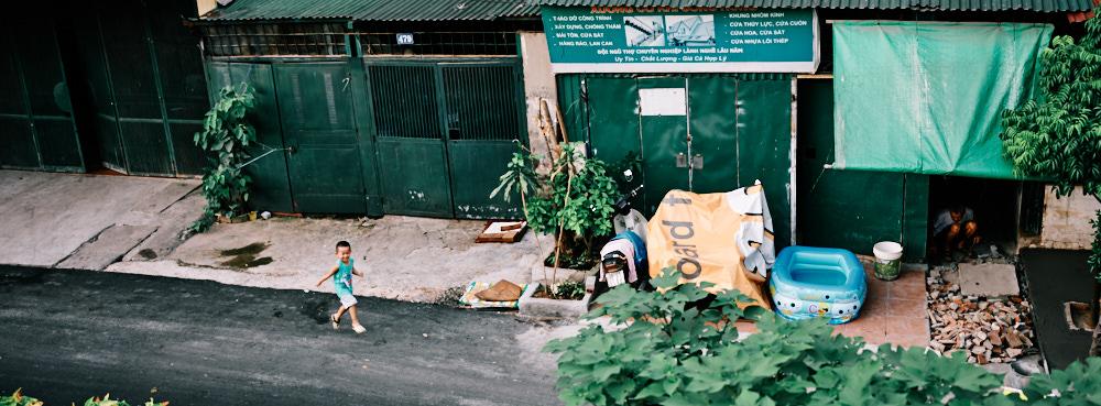 Hanoi, Vietnam - A child runs through the street