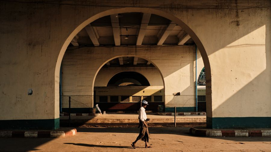 Man Walks Through Yangon Train Station