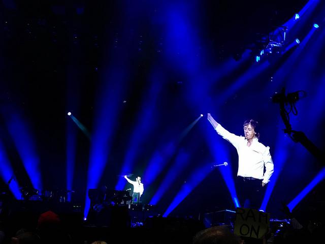 Paul McCartney Waves to Fans