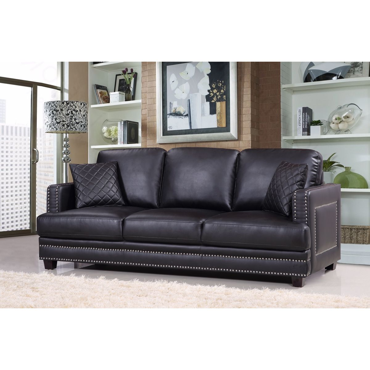 black leather sofa with nailheads natuzzi at costco meridian furniture 655bl s ferrara w silver nailhead quilted pillows