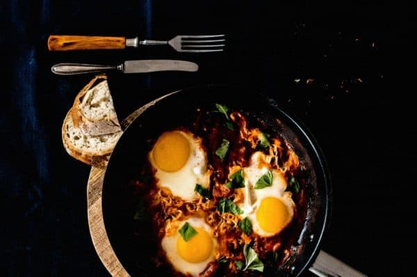 skillet with eggs cooking