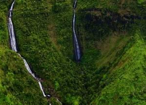 waterfalls on green mountainside