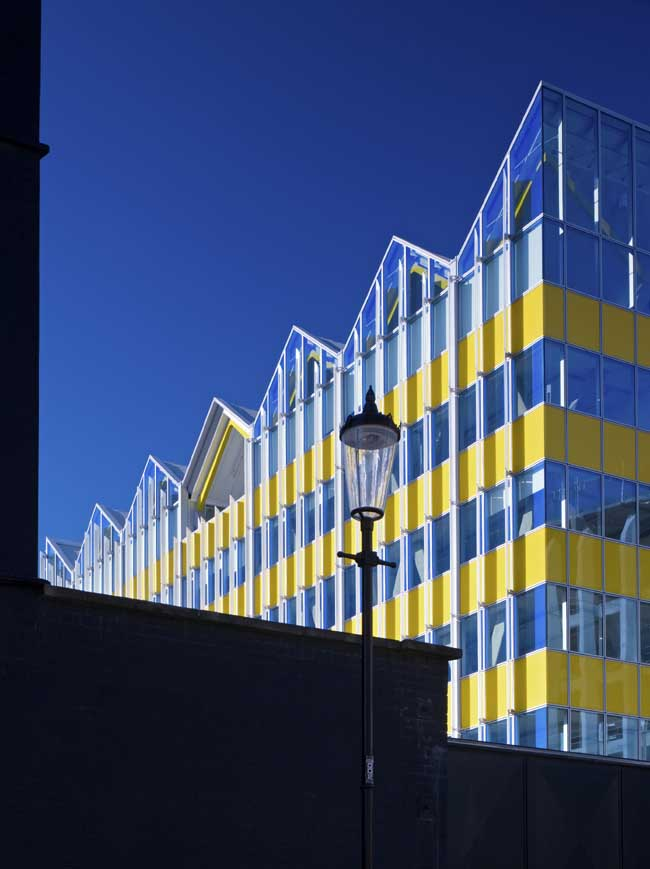 Yellow Building Monsoon Accessorize London  earchitect