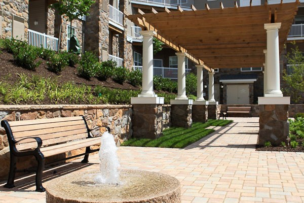 The landscape at the Mill Run Apartments boosts the value of units in the complex