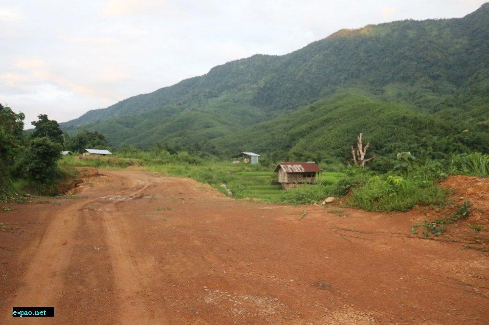 ADB road passing through agri land of bhalok