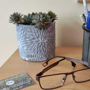 grey pot on desk