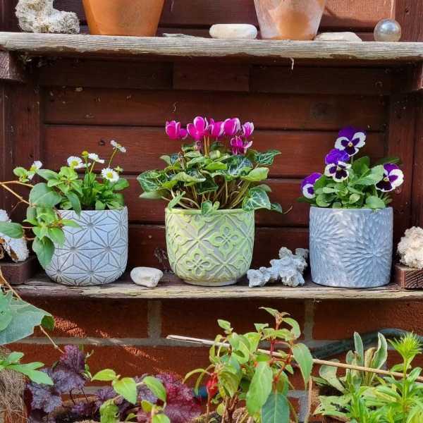 set of pots outside shelf
