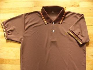 衿、袖口のラインとプリントカラーを オレンジで統一
