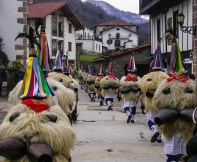 Carnival in Ituren, where men dressed like the abominable snowman walk with bells of their back. Photo courtesy of pyreneanexperience.com