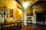 The kitchen is a prototype of a medieval kitchen with its huge central fireplace