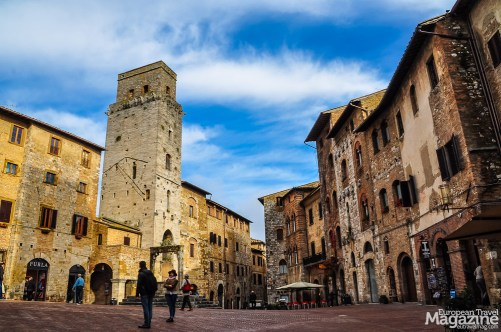 The charming Piazza della Cisterna is flanked by many historic buildings