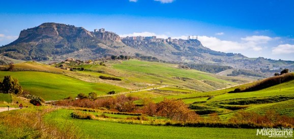 Touring the countryside of Sicily may take you past some hilltop-hugging towns like Enna