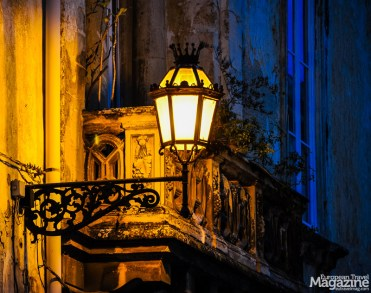 Sit in the golden gleam of the streetlights and watch the nightlife unfold