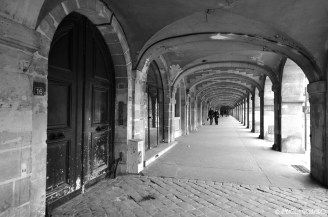 Inside the many arches at Place des Vosges