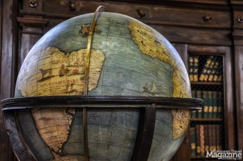 Study the celestial and terrestrial globes. There are so many details to cherish in this Baroque library, so take your time to take it in