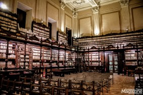 Admire the frescoes on the ceiling, the craftsmanship in the woodwork and the wonderful old volumes of books