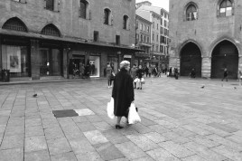 Elegant old lady, bring us to another time, at Piazza Maggiore