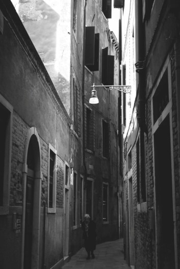 A local lady walks through one of the many mysterious alleys