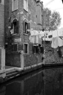 Laundry hanging along canal in a distant side of Venice, quiet and peaceful