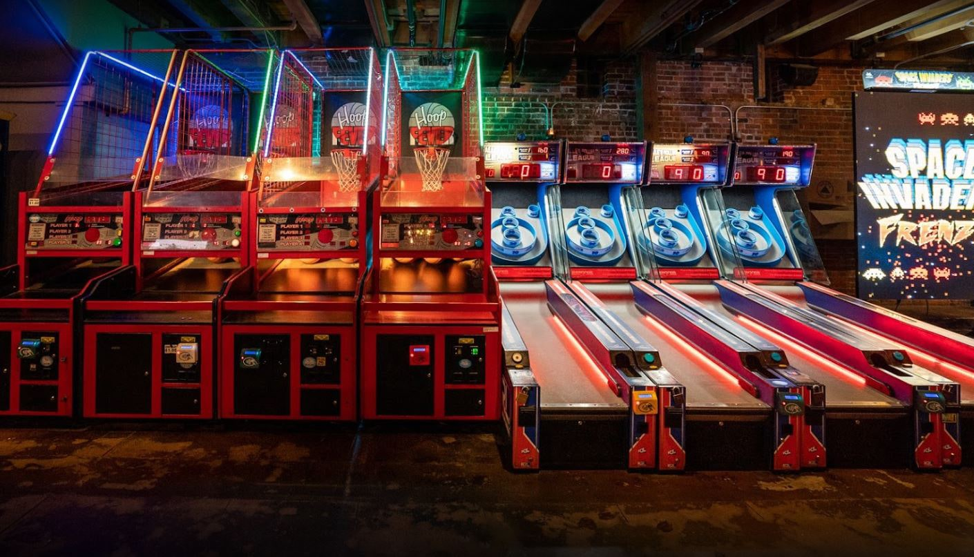 Skee-ball and coin-operated basketball game at a bar or restaurant