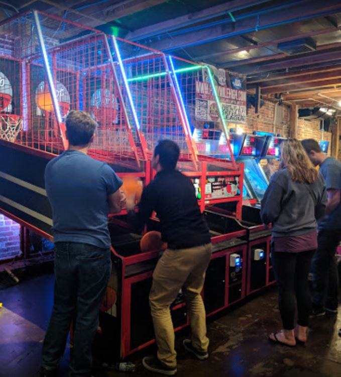 Playing Hoop Fever competitive bar games