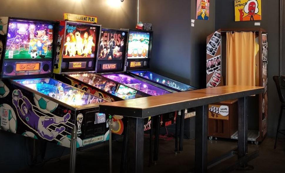 Pinball games, photobooth, shuffleboard in bar
