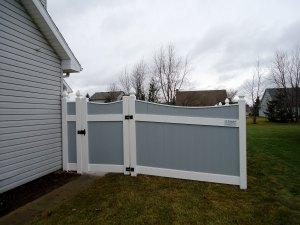 Gray vinyl Lakeland-style concave fence