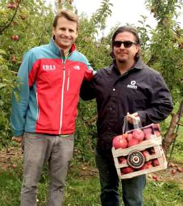 Eddie Brennan, left, co-owner of Beak & Skiff, and Tim Butler, head brewer for Empire Brewing Company, picking apples for Empire's Apple Harvest Ale. photo courtesy Empire Brewing Company